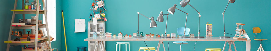 Lamps on desk with turquoise background