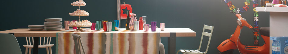 A colourfully decorated dining table in front of a dark wall